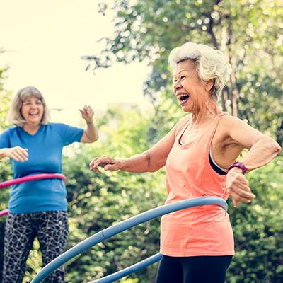 Elderly women exercising with hula hoops