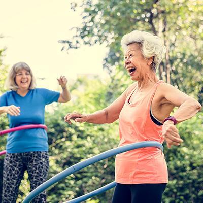 Elderly women exercising with hula hoops